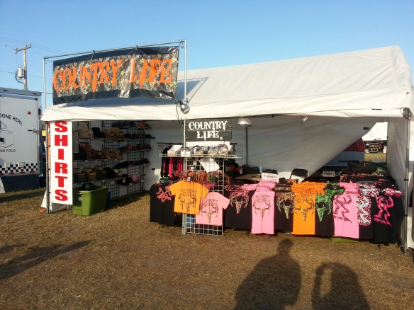 Inside a T-shirt booth, 3/15/14  Firemans' Fair, Indian River County