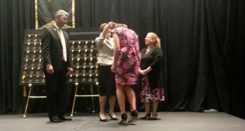 Maggie and her advisor, Dr. Ana Leona, receiving the Medallion